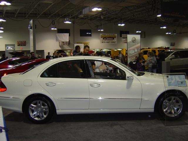 white-mercedes-e320-side-view
