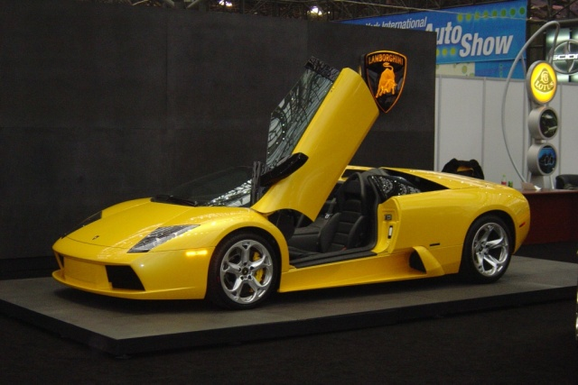 yellow lamborghini doors open