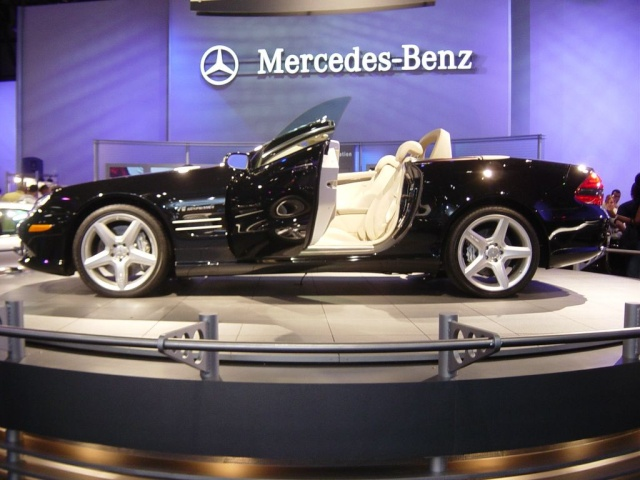 black mercedes convertible door open